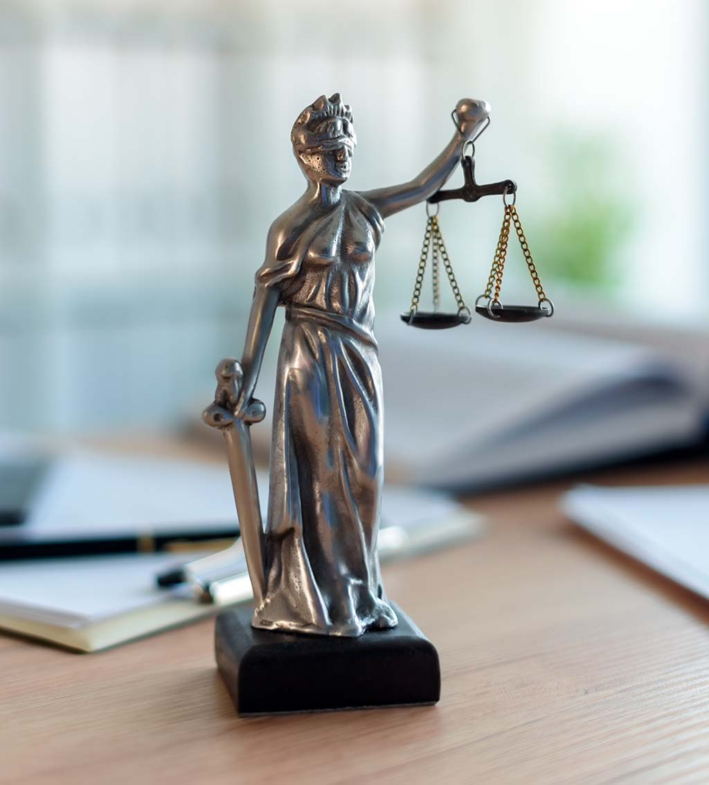 lady justice statue in a lawyer office